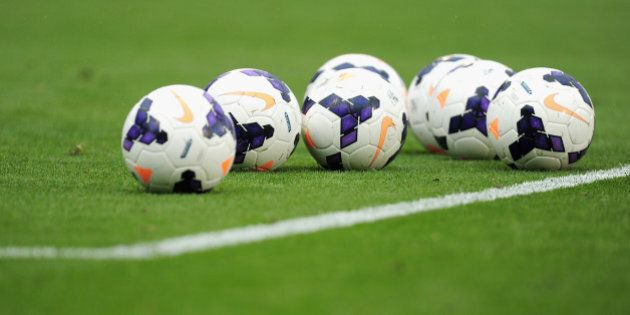 LONDON, ENGLAND - AUGUST 24:  Match balls on the pitch ahead of the Barclays Premier League match between Fulham and Arsenal at Craven Cottage on August 24, 2013 in London, England.  (Photo by Jamie McDonald/Getty Images)