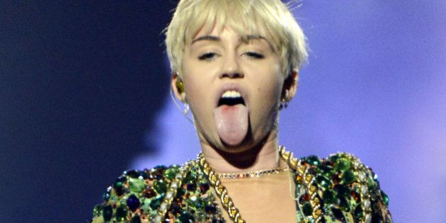 HOUSTON, TX - MARCH 16: Miley Cyrus performs part of her Bangerz Tour at the Toyota Center on March 16,...