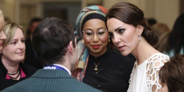 Catherine, the Duchess of Cambridge (R) speaks with guests at a reception hosted by the Governor General...