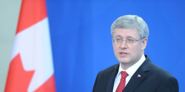 BERLIN, GERMANY - MARCH 27: Canadian Prime Minister Stephen Harper speaks during a press conference with...