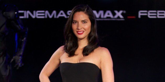 US actress Olivia Munn poses on the red carpet as she arrives for the world pemiere of the film 'Robocop'...