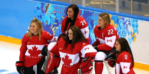 SOCHI, RUSSIA - FEBRUARY 06:  Meghan Agosta-Marciano #2, Natalie Spooner #24, Shannon Szabados #1, Hayley Wickenheiser #22 and Laura Fortino #8 of Canada pose for photo on the ice prior to their Women's Ice Hockey practice session ahead of the Sochi 2014 Winter Olympics at the Shayba Arena on February 6, 2014 in Sochi, Russia.  (Photo by Martin Rose/Getty Images)