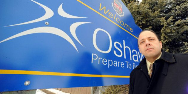 Jan2309RE11153879Oshawa Councillor Robert Lutczyk in front of Oshawa swelcome sign on the East side of...