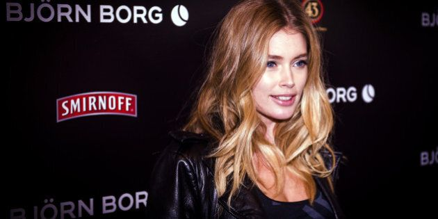 Dutch top model Doutzen Kroes poses as she arrives at the Bjorn Borg autumn/winter collection fashion show in Amsterdam on January 22, 2014.   AFP PHOTO / ANP / REMKO DE WAAL***netherlands out***        (Photo credit should read REMKO DE WAAL/AFP/Getty Images)