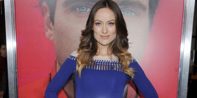 LOS ANGELES, CA - DECEMBER 12: Actress Olivia Wilde arrives at the Los Angeles premiere of 'Her' at Directors...
