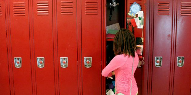 WASHINGTON D.C.  June 20: Sixth grader Milan Harris, 11, empties her locker on June 20, 2014, the last day of class at Alice Deal Middle School in Northwest D.C. Harris is nervous about moving upstairs to the seventh grade, because it smells different. Like big kids, kinda stinky, she said. (Jessica Contrera/The Washington Post via Getty Images)