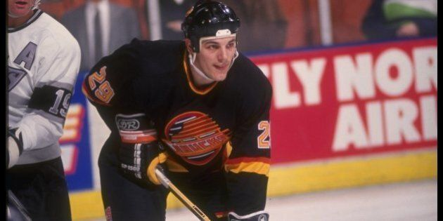 1990-1991: Leftwinger Gino Odjick of the Vancouver Canucks. Mandatory Credit: Ken Levine