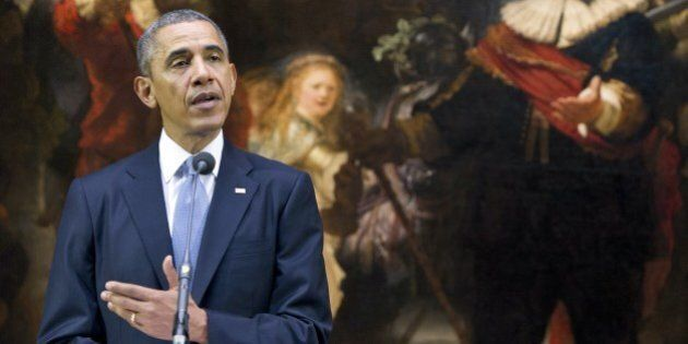 US President Barack Obama speaks in front of Rembrandt's 'Night Watch' during a joint press conference...