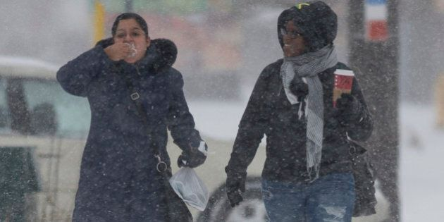 TORONTO - DECEMBER 14 - Catalina Muggli (left) tastes a bit of freshly fallen snow as she and Janice...
