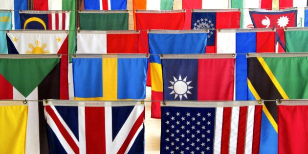 flags of many nations hang...