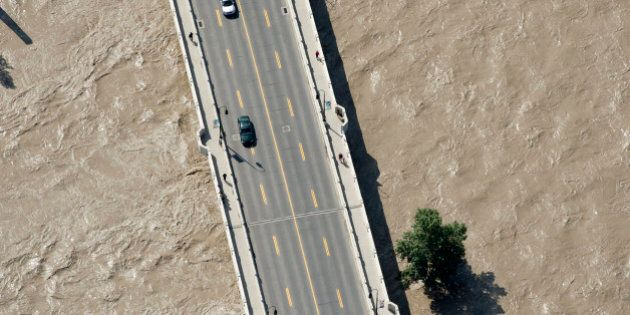 This aerial photo shows a flooded downtown Calgary, Alberta, Canada on Saturday, June 22, 2013. The two...