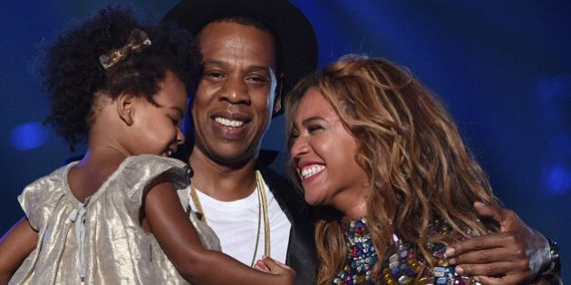 INGLEWOOD, CA - AUGUST 24: (L-R) Blue Ivy Carter, recording artists Jay Z and Beyonce speak onstage during...