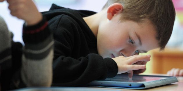 Nursery school pupils work with tablet computers on March 18, 2013 in Haguenau, northeastern France....