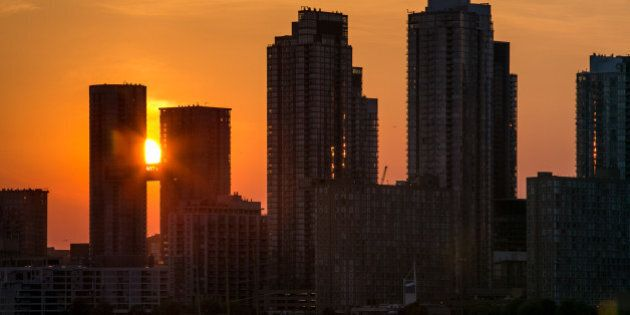 TORONTO, CANADA - JUNE 28: New office and condominium buildings line the Harbourfront as viewed at sunset...