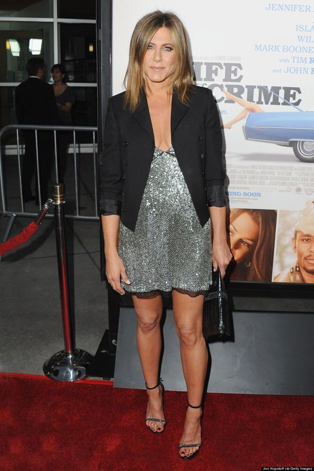 Jennifer Aniston Sizzles In Low-Cut Mini