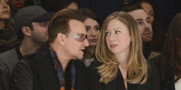 NEW YORK, NY - FEBRUARY 09: Bono and Chelsea Clinton front row at Edun - Mercedes-Benz Fashion Week Fall...