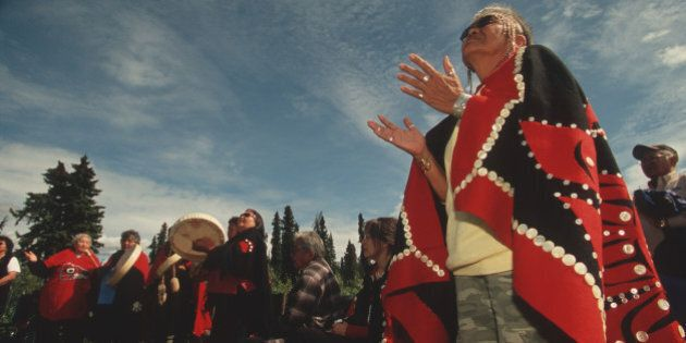 Lili Moyer, a Tahltan leader, prays at a ceremony celebrating the Sacred Headwaters, birthplace of three...
