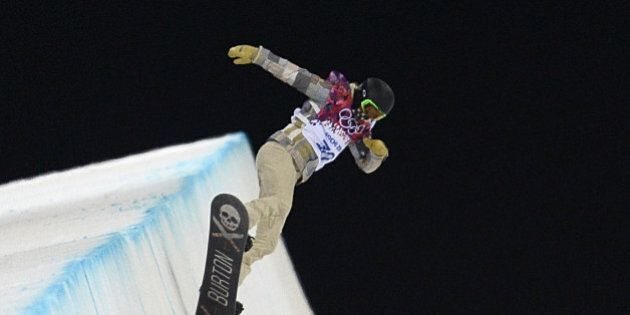 US snowboarder Shaun White takes part in a Men's Snowboard Halfpipe training session at the Rosa Khutor...