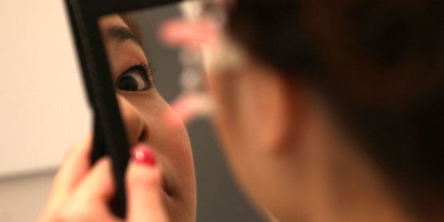 HIMEJI, JAPAN - JANUARY 13: 20 years old woman looks from mirror after finished her fitting for'Coming-of-Age...