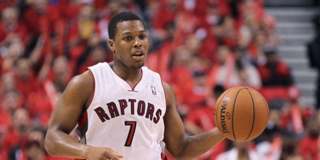 TORONTO, ON - MAY 4: Kyle Lowry #7 of the Toronto Raptors plays against the Brooklyn Nets in Game Seven...