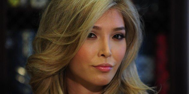 Jenna Talackova looks on at a press conference in Los Angeles with her attorney Gloria Allred (not pictured)...