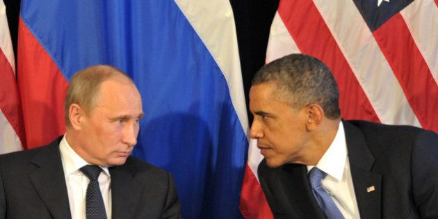 US President Barack Obama (R) meets his Russian counterpart Vladimir Putin (L) in Los Cabos, Mexico,...