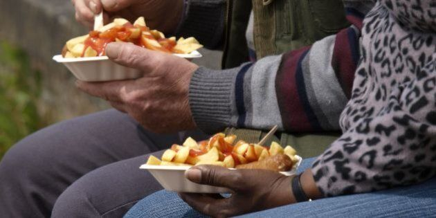 Eating take away chips, UK. (Photo by: Education Images/UIG via Getty