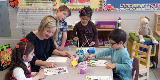 TORONTO, ON - MAY 9 - Kindergarten teacher Stacey Fleming and kids at Toronto's Twentieth Street Junior...