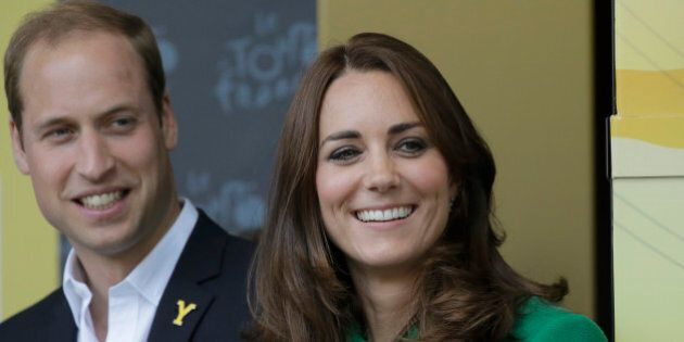 Kate, Duchess of Cambridge and Prince William watch the podium ceremony of the first stage of the Tour...