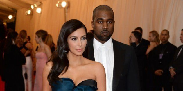 Kim Kardashian, left, and Kanye West attend The Metropolitan Museum of Art's Costume Institute benefit...