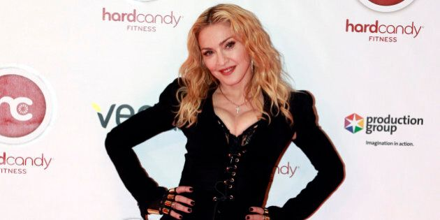 TORONTO, ON - FEBRUARY 11  -  Madonna poses on the red carpet during a visit to Toronto's Hard Candy Fitness, February 11, 2014.        (Andrew Francis Wallace/Toronto Star via Getty Images)