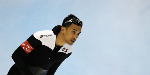 HEERENVEEN, NETHERLANDS - MARCH 08: Gilmore Junio of Canada looks on after he competes in the Mens 500m...