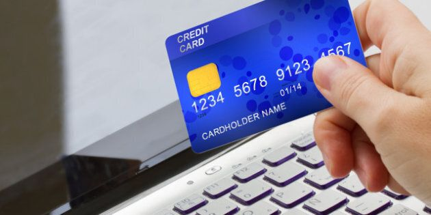 hand holding plastic card