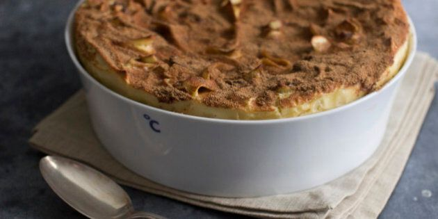 This July 28, 2014 photo shows apple honey kugel in Concord, N.H. The blend of mascarpone, sour cream and light cream, with the help of six eggs, creates a lighter, makes a more delicate dessert. (AP Photo/Matthew Mead)