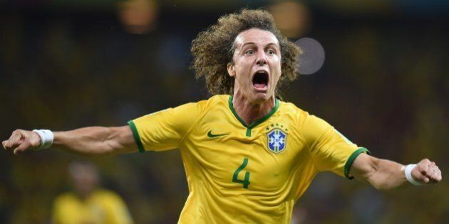 Brazil's defender David Luiz celebrates scoring during the quarter-final football match between Brazil and Colombia at the Castelao Stadium in Fortaleza during the 2014 FIFA World Cup on July 4, 2014. AFP PHOTO / VANDERLEI ALMEIDA        (Photo credit should read VANDERLEI ALMEIDA/AFP/Getty Images)