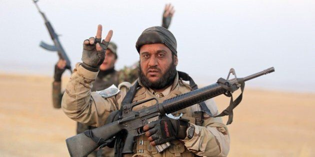 SALADIN, IRAQ - AUGUST 31: A Shiite militian flashes victory sign after Iraqi forces have entered the...