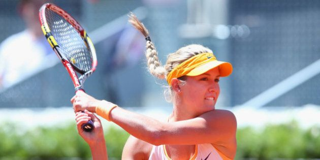 MADRID, SPAIN - MAY 05: Eugenie Bouchard of Canada in action against Agnieszka Radwanska of Poland during...