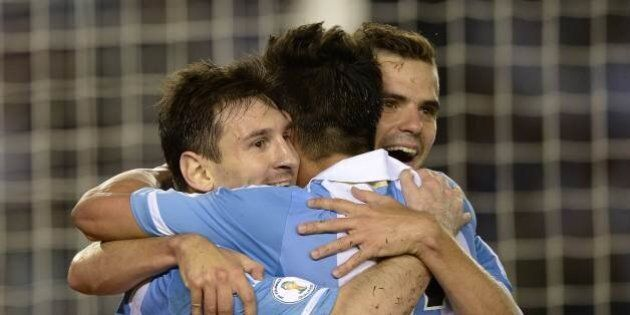 TOPSHOTS Argentina's forward Lionel Messi (L) celebrates with teammates forward Ezequiel Lavezzi (C) and midfielder Fernando Gago after shooting a penalty to score his team's second goal against Venezuela during a Brazil 2014 World Cup South American qualifier football match at the Monumental stadium in Buenos Aires, on March 22, 2013. AFP PHOTO / Juan Mabromata (Photo credit should read JUAN MABROMATA/AFP/Getty Images)