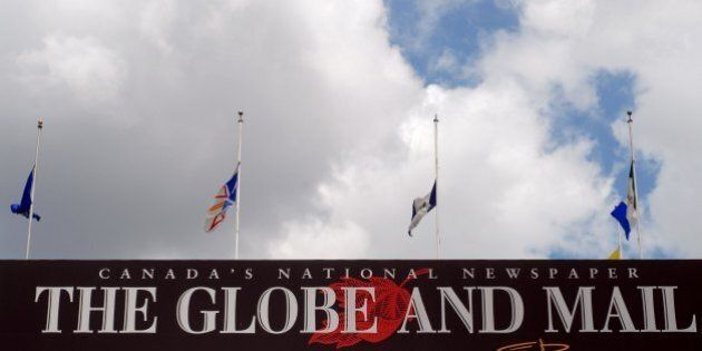 TORONTO - JUNE 13: Flags fly at half mast on the Globe and Mail newspaper headquarters in downtown on...