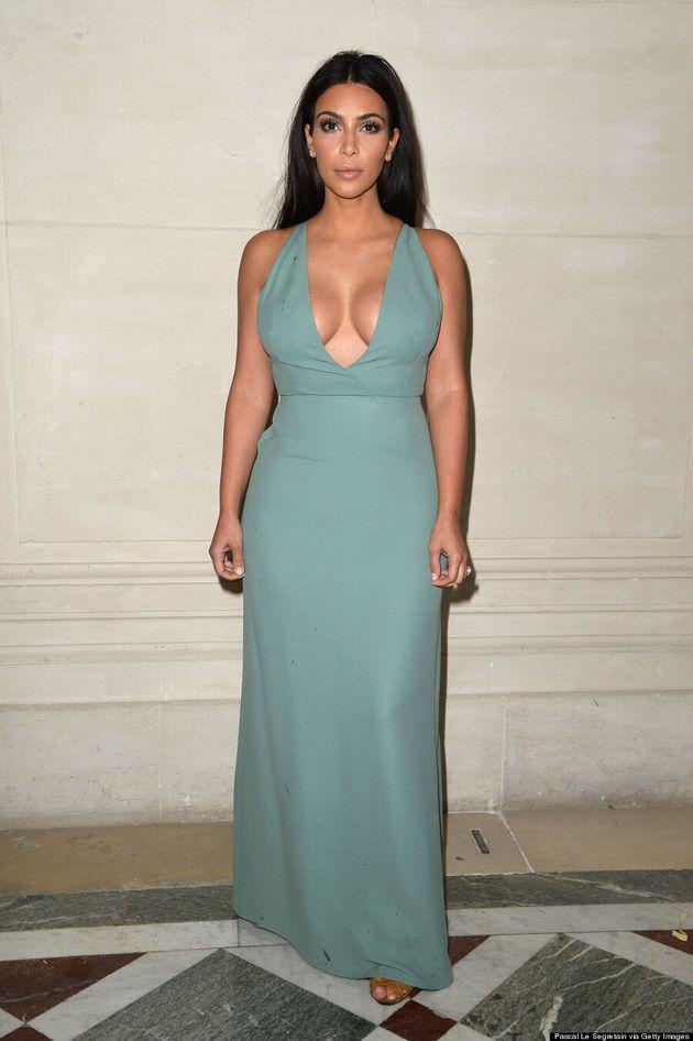 Kim Kardashian Turns Heads In Plunging Valentino Gown At Paris Fashion