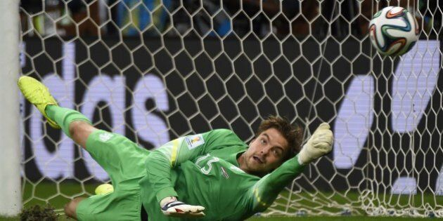 Netherlands' goalkeeper Tim Krul saves a penalty during the penalty shoot-out of the quarter-final football...