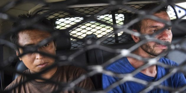 FALFURRIAS, TX - JULY 24 : A Mexican illegal immigrant, left, and a Honduran lllegal immigrant, right,...
