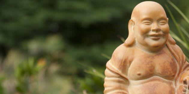 small terracotta buddha...