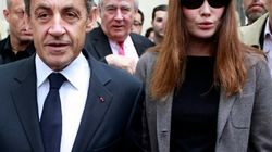 As Police Raid His Office, Sarkozy Vacations With Canadian