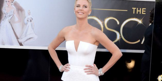 HOLLYWOOD, CA - FEBRUARY 24: Charlize Theron arrives at the Oscars at Hollywood & Highland Center on...