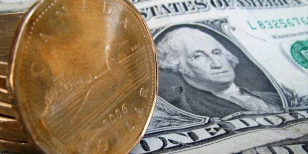 CAD Exchange Rate: Canadian Dollar Drops Below Parity After BoC Signals Weaker Economy