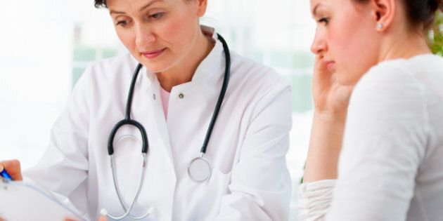 doctor explaining diagnosis to her female