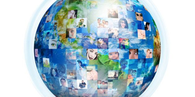 A globe is isolated on a white background with many different people's faces. Can represent a technology...