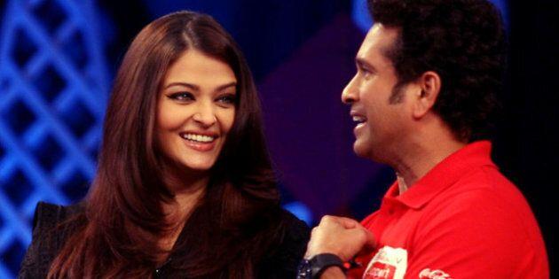 Indian Bollywood actress Aishwarya Rai Bachchan (L) and Indian cricketer Sachin Tendulkar participates...