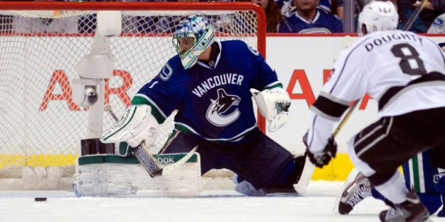 VANCOUVER, CANADA - APRIL 11: Roberto Luongo #1 of the Vancouver Canucks makes a save as Drew Doughty...